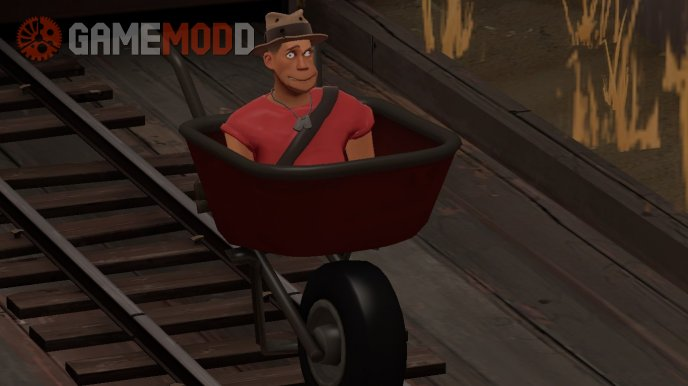 Scout in wheelbarrow.